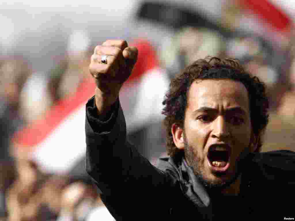 A protester shouts anti-Mubarak slogans after Friday Prayers in Tahrir Square.