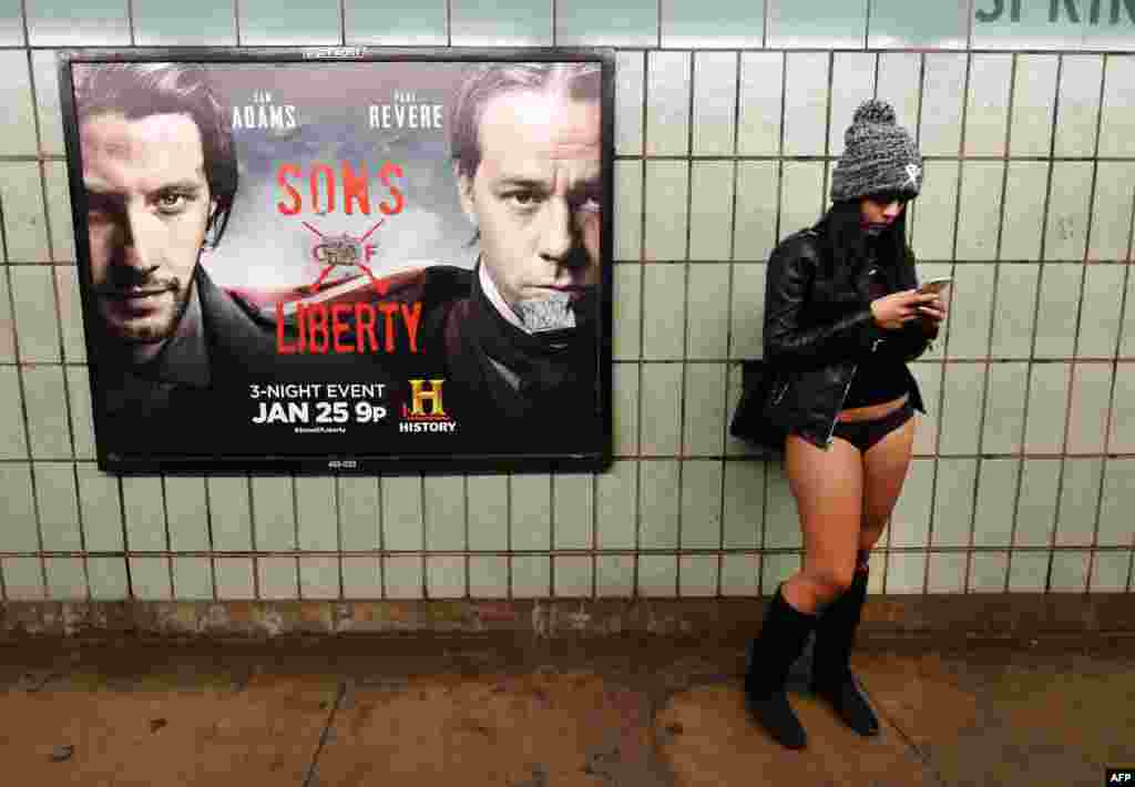 A participant in the No Pants Subway Ride waits for a train in her underwear in New York City. The annual event began in 2002 by Improv Everywhere. The goal is for riders to get on subway trains dressed in normal winter clothes without pants and keep a straight face. (AFP/Timothy A. Clary)