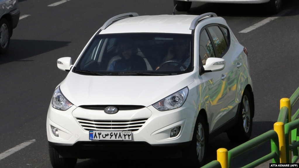 A Picture Taken On September 12, 2015 Shows An Iranian Man Driving A Hyundai  Ix45