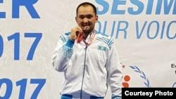 Казахстанский борец Асылжан Тажиев, призер Сурдлимпиады в Турции.