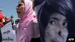 Աֆղանստան - Կանանց դեմ բռնությունը բացառող օրենքի ընդունման պահանջով ցույց Քաբուլում, մայիս, 2013թ.