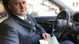 "RUSSIA -- Soviet revitalist Konstantin Vyatkin showd off his ""Soviet"" passport, Moscow, April 2019"