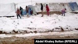 ثلوج في مخيم دوميز للاجئين السوريين في دهوك