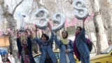 Iranian girls hold up numbers forming the Persian new year 1398 ahead of Norouz in Tehran on March 20.