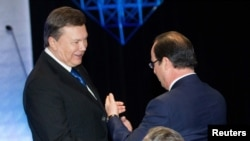 Viktor Januković i Fransoa Oland na samitu u Vilnjusu