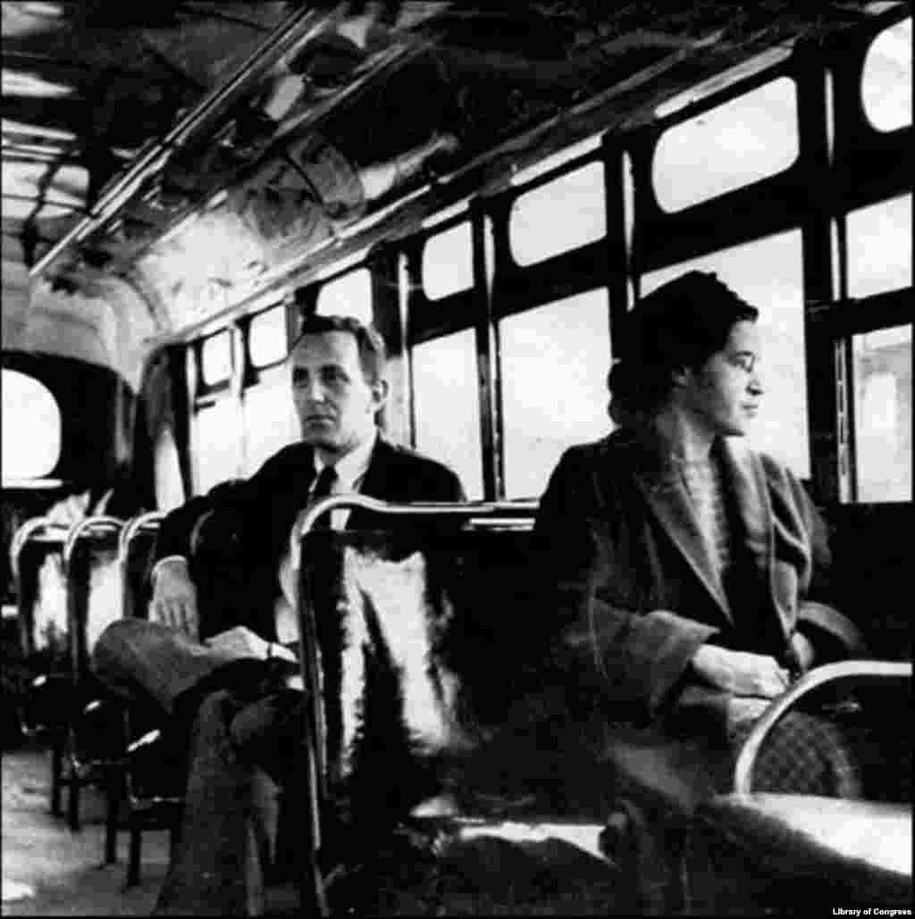 Rosa Parks sits with a journalist in the front of a bus in Montgomery, Alabama, in 1956, after the U.S. Supreme Court ruled segregation illegal on the city's transport system. The court case was the result of the bus boycott initiated by Parks and fellow activists.