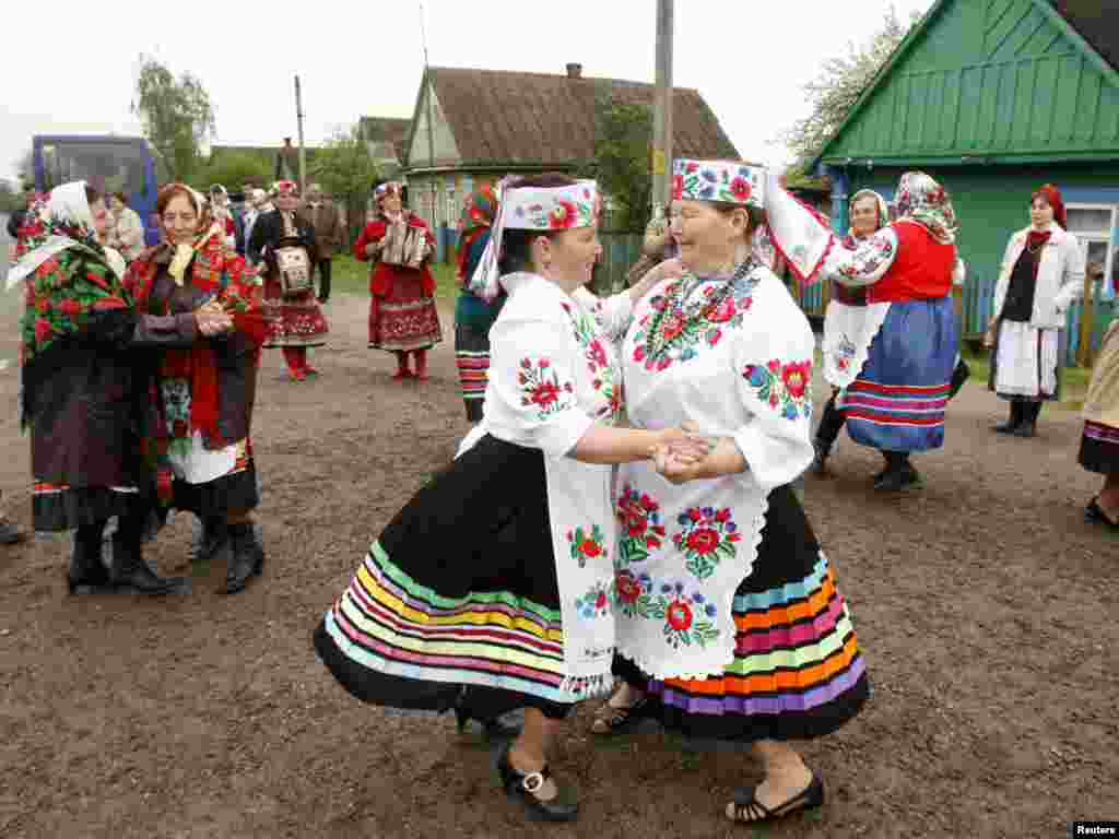 Women in national costume dance during Yurya, a celebration to ensure good harvests, in the village of Pogost, Belarus, on May 6. Photo by Vasily Fedosenko for Reuters