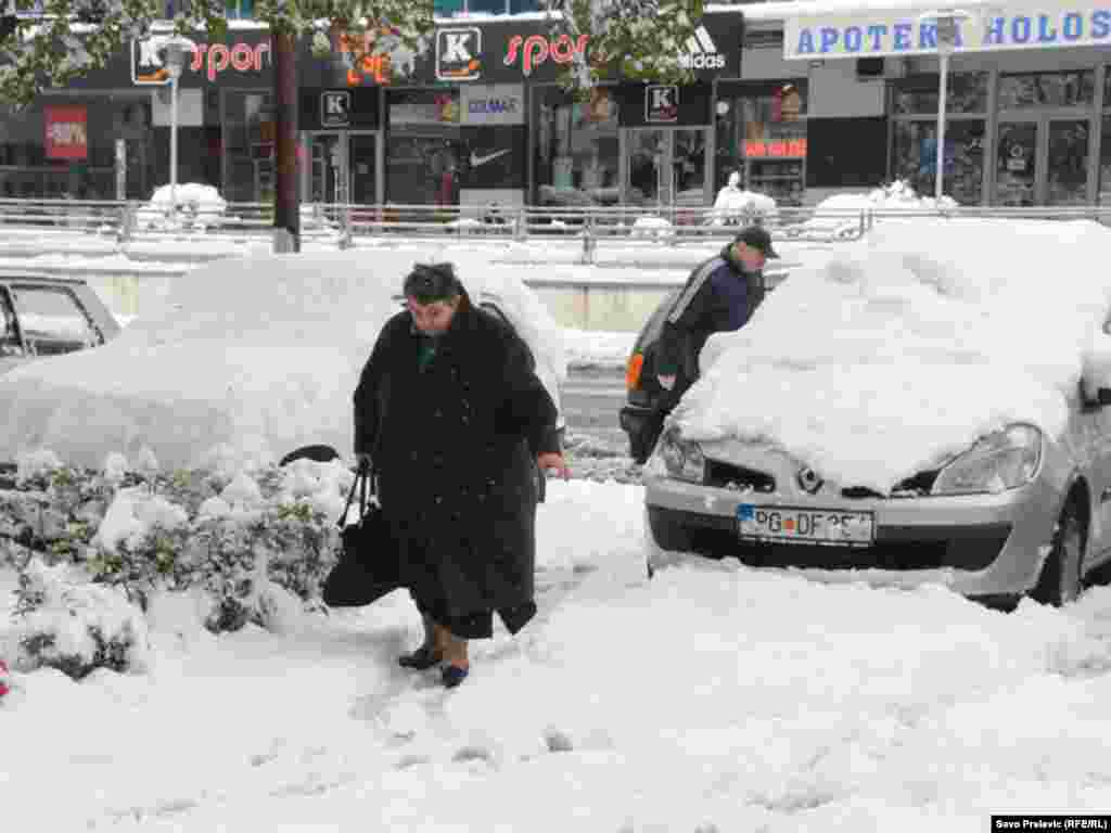 Residents of Montenegro's capital, Podgorica, dig out after a recent snowfall. The northern parts of the country saw temperatures of -22 Celsius on February 2.