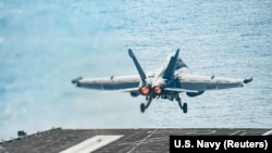 An F/A-18E Super Hornet launches from the flight deck of the U.S. Navy aircraft carrier USS Harry S. Truman in the Arabian Sea, January 6, 2020
