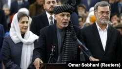 Afghan President Ashraf Ghani (center) is up against warlords, former communists, and mujahedin.