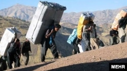 "Bent under the weight of their loads -- smuggled cigarettes, alcohol, gasoline, and even home appliances -- the ""mules"" are a common sight in Iran's western border regions."