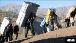 Kurdish porters cross the Iran-Iraq border. Small scale smuggling is done by sending porters across the border. File photo