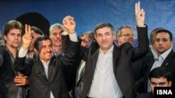 Iranian president Mahmud Ahmadinejad (center left) accompanied his close adviser Esfandiar Rahim Mashaei as he registered for the upcoming presidential election.