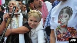 Yulia Tymoshenko greets her supporters during a rally in front of Kyiv district court on June 24.