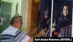 المصور حسن الحبيب امام صورته الفائزة
