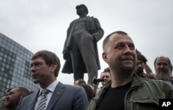 Oleh Tsaryov (left) is seen with separatist leader Aleksandr Borodai in Donetsk in June 2014.