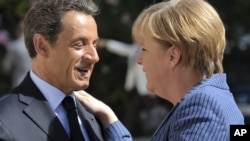 French President Nicolas Sarkozy (left) with German Chancellor Angela Merkel