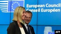 Обладатели новых евродолжностей: Федерика Могерини и Дональд Туск
