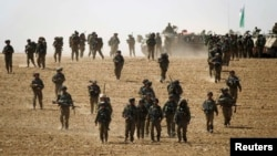 حرکت سربازان اسرائیلی به سمت نوار غزه. ۱۲ ژوئیه ۲۰۱۴.