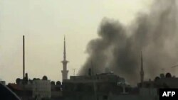 A video posted on April 5 shows smoke billowing from reported shelling in Duma, outside Damascus.