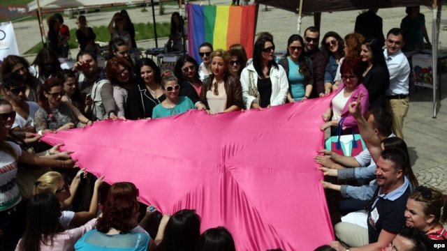 Rights activists of the LGBT community hold a pink triangle, a symbol used in Nazi concentration camps to identify gays and lesbians, on the occasion of the International Day Against Homophobia in Tirana on May 17.