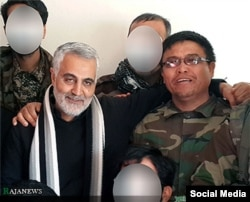 Qasem Soleimani (left) with Afghan Alireza Tavasoli, commander of the Fatemiyoun Brigade, who was killed fighting in Syria. (undated photo)