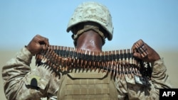 A US Marine removes ammunition from around his neck during an exercise in Helmand province (file photo).