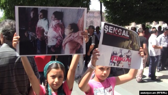 Armenia -- Armenian Yazidi children hold posters during a protest action in front of the Prime Minister's Office, Yerevan, 14 August 2014