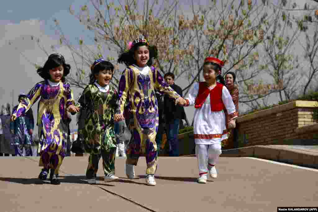 Young Tajik girls wearing traditional dresses celebrating the spring Norouz festival in Dushanbe. (AFP/ Nozim Kalandarov)