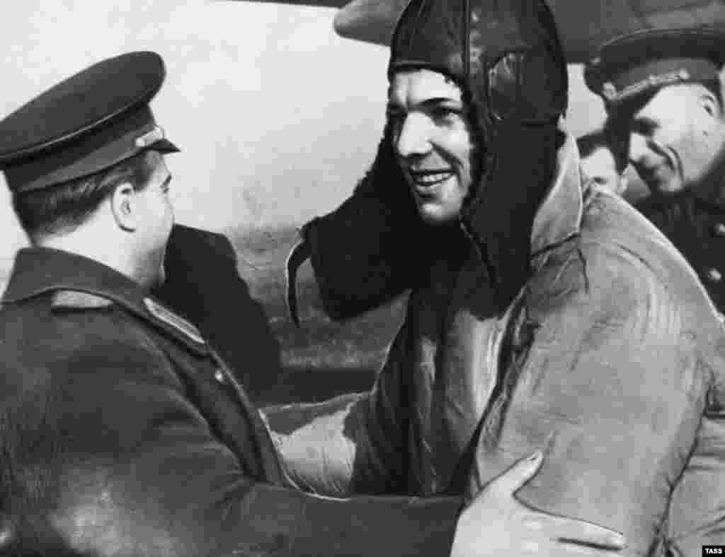 Gagarin is congratulated after the successful flight.