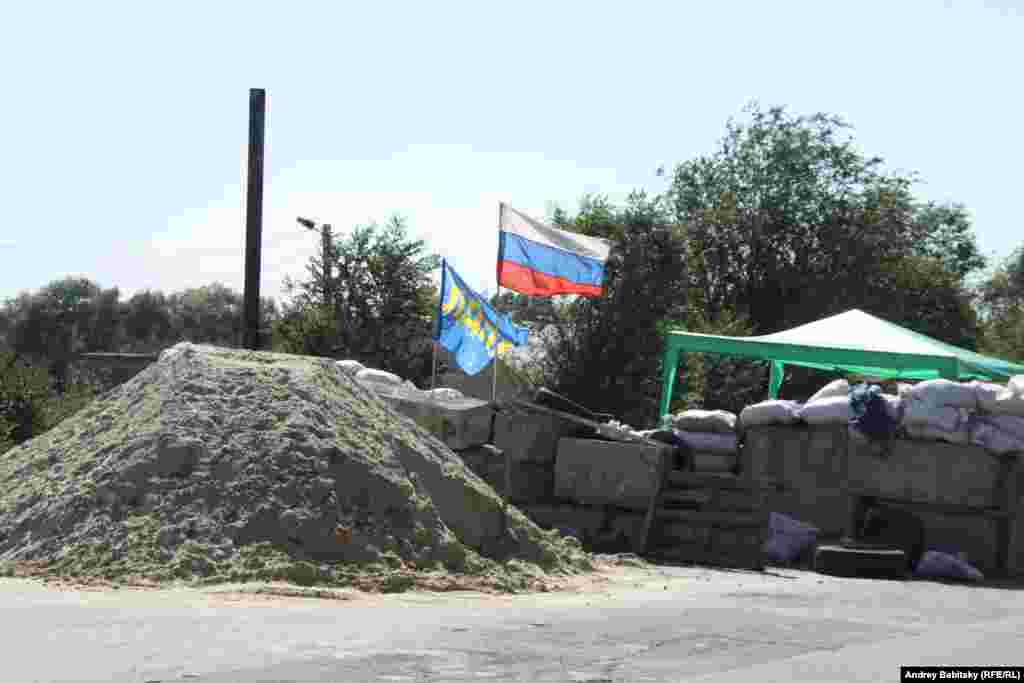 Near the city of Luhansk, pro-Russian separatists man a checkpoint.