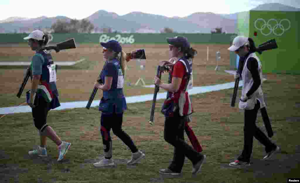 Chiara Cainero of Italy (left to right), Amber Hill of United Kingdom, Morgan Craft of the United States, and Wei Meng of China take part in the women's skeet finals.