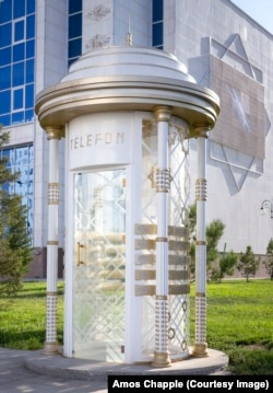 """A """"dalek""""-like phone booth in the center of Ashgabat."""