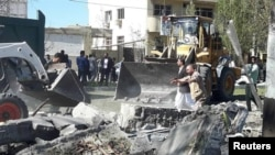 General view of damages after a bomb inside a car exploded outside a police station in Chabahar, Iran December 6, 2018. Tasnim News Agency /Reuters