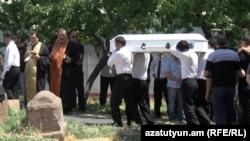Armenia - The funeral of Mary Markarian and her newborn baby who died in hospital, 1 August, 2015