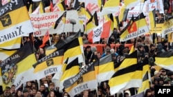 "Russian ultranationalists wave tsarist black-yellow-white flags as they take part in the ""Russian March"" in central Moscow in November 2012."