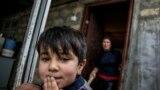 Пятилетний Адыгезель на пороге своего дома