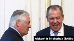Tillerson (left) with Russian Foreign Minister Sergei Lavrov in Vienna in December