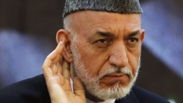 "Afghan President Hamid Karzai said there were ""foreign hands"" behind the Taliban's new office."