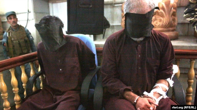 Two of the defendants are seen in the dock in Kabul on September, where the court needed just a few hours to sentence the seven men to death for the attack, which took place in the district of Paghman.