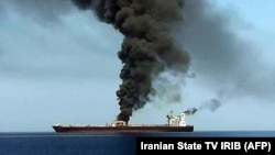A TV grab reportedly shows smoke billowing from a tanker attacked off the coast of Oman, June 13, 2019