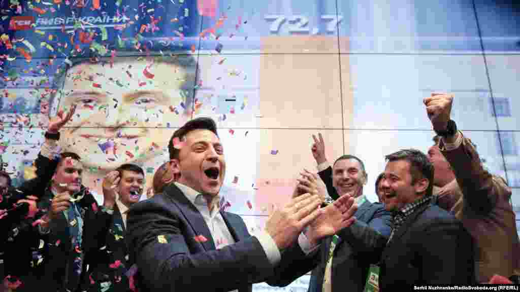 Ukrainian presidential candidate Volodymyr Zelenskiy celebrates in Kyiv after exit polls showed he was on his way to a landslide victory in the April 21 presidential runoff vote. (Serhii Nuzhnenko, RFE/RL)