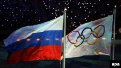 The Olympic flag and the Russian flag during the closing ceremonies of the 2014 Olympic Games in Sochi