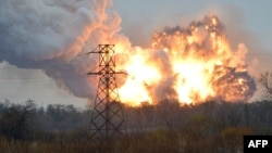 "A ball of fire is seen following an explosion on the outskirts of the eastern city of Donetsk on October 20. Human Rights Watch cited ""particularly strong evidence"" that Ukrainian military forces had used cluster munitions on several occasion in Donetsk, a rebel stronghold with a prewar population of around 1 million people."