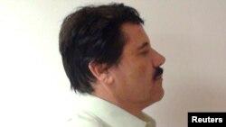 """Хоакин """"Коротышка"""" Гусман в феврале 2014 года, сразу после первого ареста"""