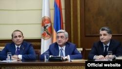 Armenia -- President Serzh Sarkisian (C) introduces new Prime Minister Hovik Abraamian (L) and thanks outgoing Prime Minister Tigran Sarkisian (R), Yerevan, 13Apr2014