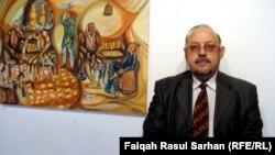 الهاشمي أمام احدى لوحاته