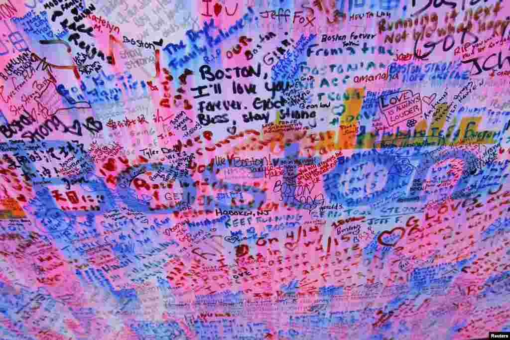 Messages left at a memorial for the victims of the Boston Marathon bombings.