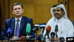 Russian Energy Minister Aleksandr Novak (left) and Mohammed bin Saleh al-Sada, president of OPEC (file photo)