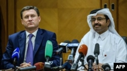 Russian Energy Minister Aleksandr Novak (left) worked with Mohammed bin Saleh al-Sada, president of the Organization of Petroleum Exporting Countries, on a deal to curb output.